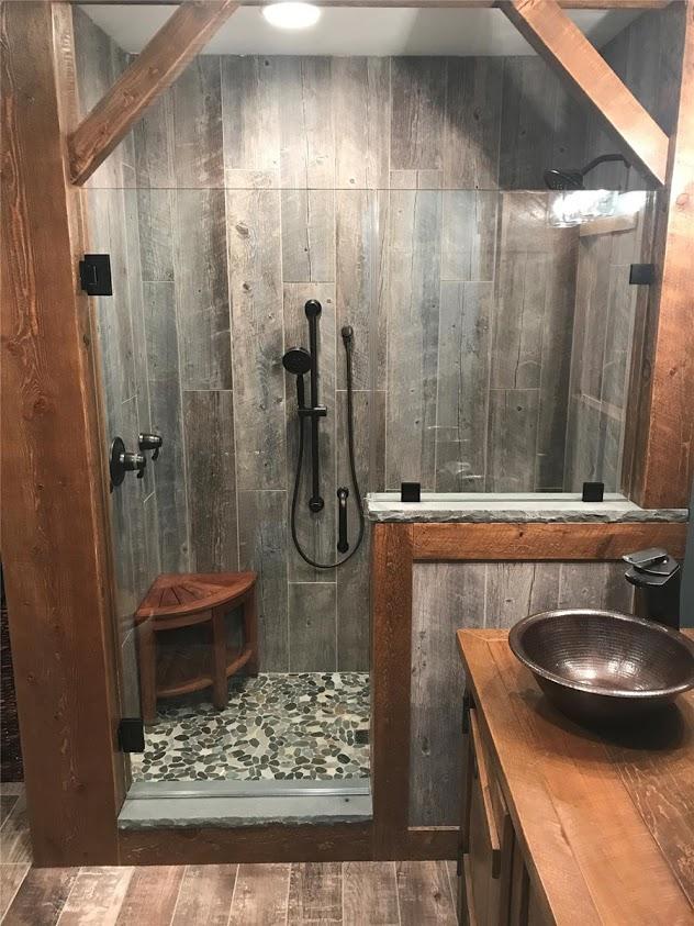 photo of rustic shower with glass door